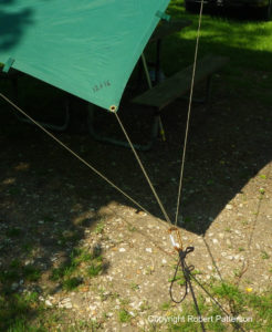 Use this setup to keep individual grommets from ripping out in heavy wind.